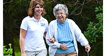 visiting angel walking with senior